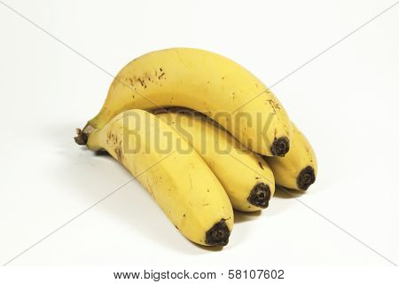 Four Yellow Ripe Bananas Isolated On White
