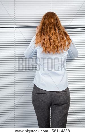 Spying Or Curious Businesswoman