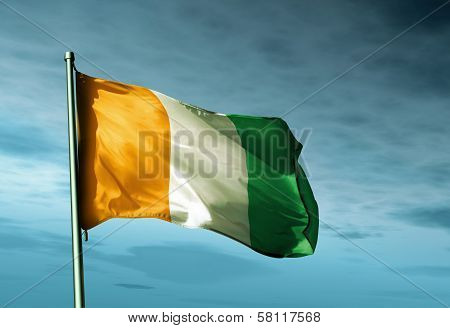 Cote d'Ivoire flag waving in the evening