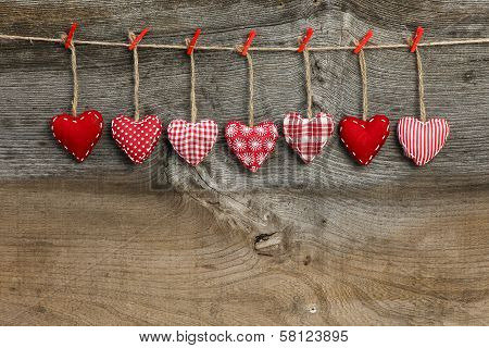 Gingham Love Valentine's Hearts Hanging On Wooden Texture Background
