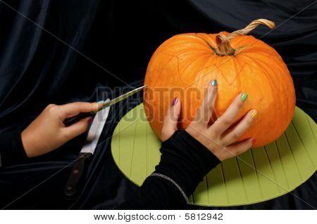 Cutting The Halloween Pumpkin