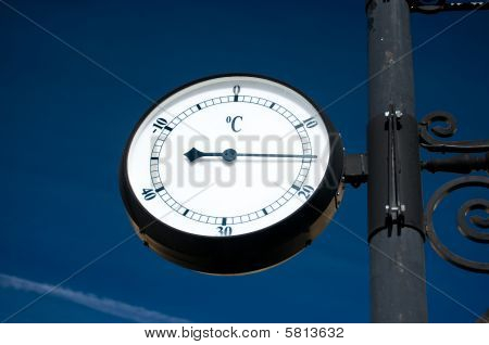Thermometer Under A Blue Sky