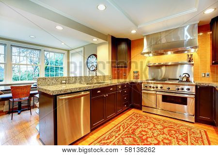 Shiny Kitchen With Black Wood Cabinets