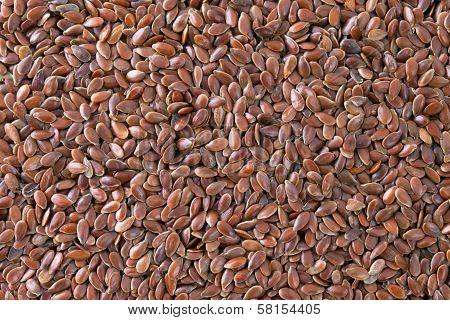 Flax Seeds (linum Usitatissimum) Texture Background.