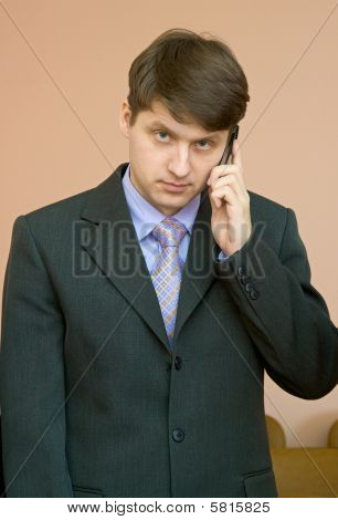 Man Speaks By A Mobile Phone