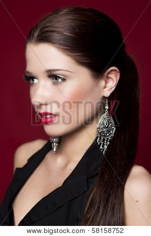 Fashionable woman with silver earrings