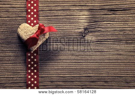 On Red polka dot ribbon heart-shaped biscuits - wood background