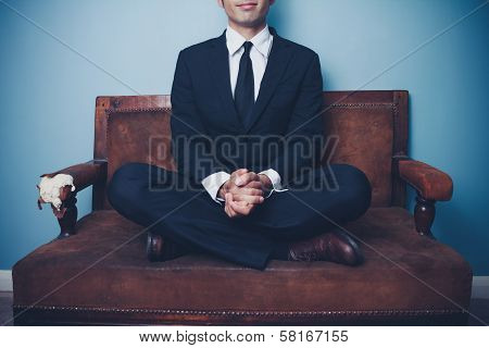 Calm Businessman Sitting With Legs Crossed