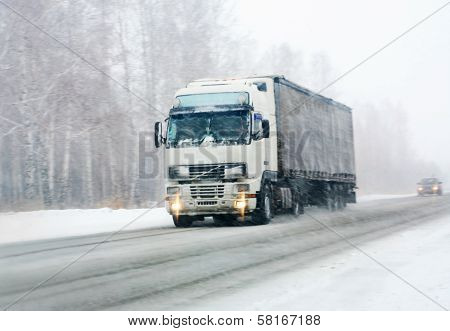 Truck Goes On Winter Road