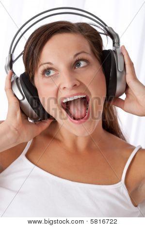 Brown Hair Woman Enjoying Music