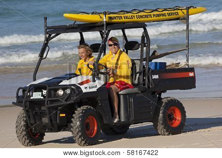 Two Beach Lifesavers In A Surf Patrol Cart. Fingal Bay. Port Stephens. Australia.