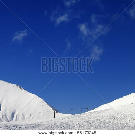 Ski Slope With Chair Lift At Sunny Winter Day