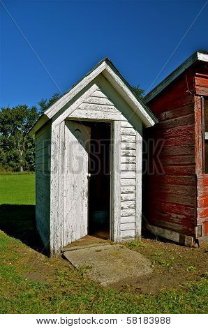 Outhouse Door Left Open