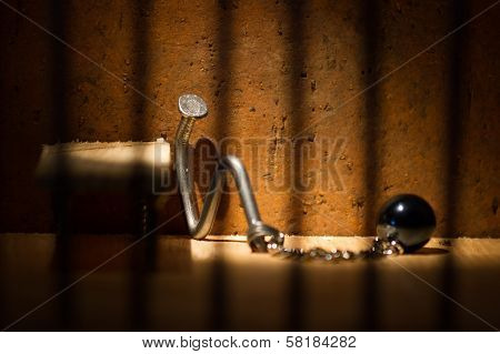 Conceptual Jail Photo With Iron Nail Ball And Chain