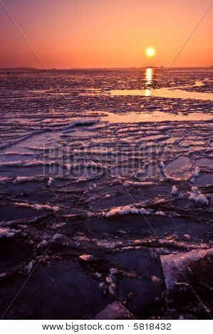 Frozen Lake And Sunset