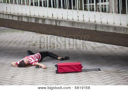 Unconscious Woman On Asphalt Road