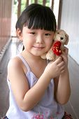 Girl Holding Toy Dog poster