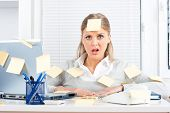 picture of adults only  - Young businesswoman with too much work to do - JPG