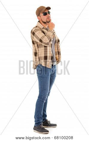 latin man in flannel shirt cap and sunglasses standing fullbody