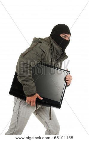 young thief wearing black hood and jacket