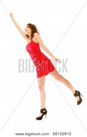 Full Length Woman In Elegant Red Dress Holding Imaginary Balloons And Flying
