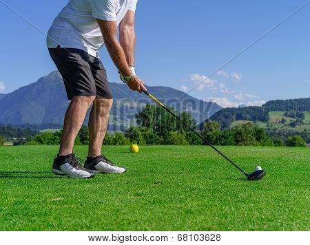 Golfer Swinging Driver