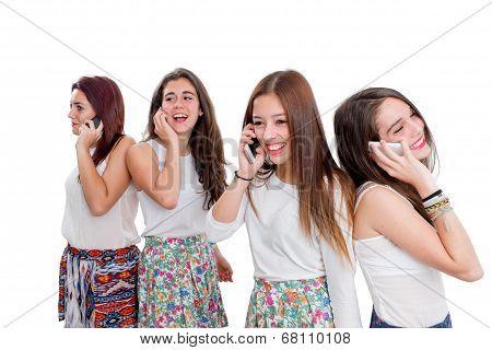 Group Of Teen Girls Talking On Smart Phones