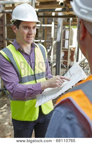 Architect Discussing Plans With Builder