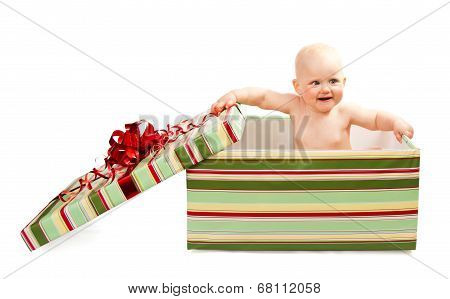 Cute baby in gift box