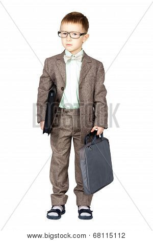 Young Boy In Grey Suit And Bow Tie Standing And Looking On Camera (isolated On White)
