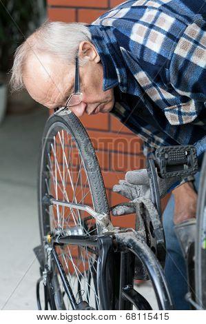 Repairman Checking Bicycle Chain