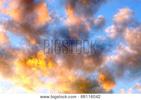 Beautiful blue sky with colorful storm clouds at sunset