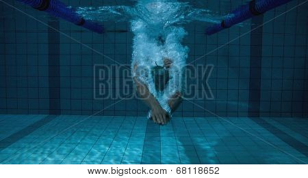Fit swimmer training on his own in the swimming pool at the leisure centre