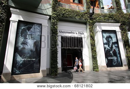 UNIVERSAL CITY, CALIFORNIA - TUES. JUNE 24, 2014: Shoppers walk past an Abercrombie & Fitch clothing store in Universal City, California, on Sunday, June 22,  2014.