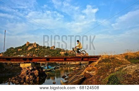 Man Riding Bike At Vietnamese Countryside