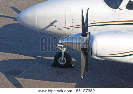 A close up look at the propeller of a small business airplane