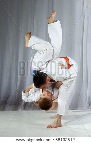 Paired exercises are performing throws athletes in judogi