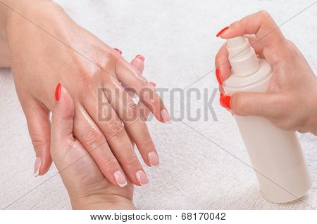 manicure applying - moisturising