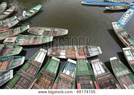 Tam Coc, Ninh Binh, Vietnam. Tour tourist boats in bay near Bich Dong