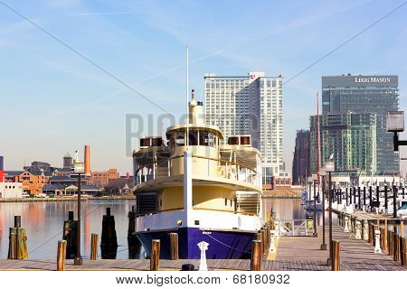 The Inner Harbor during winter with Raven yacht at the dock and Legg Mason Tower and Marriot Hotel i