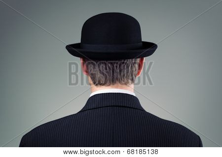 Businessman in bowler hat concept for business, finance, insurance and english culture