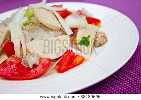 Thai Dressed Spicy Salad Wih Pork, Tomatoes And Cellophane Noodle.