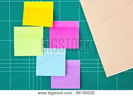 Colorful Sticky Notes Amd Notebook On Cutting Mat.