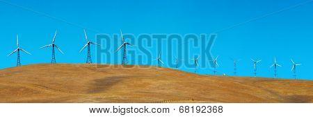 Wind turbine over mountain near San Francisco.