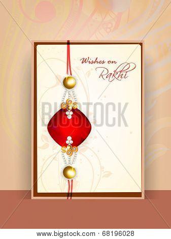 Beautiful greeting card design with rakhi on floral decorated brown background for Happy Raksha Bandhan celebrations.