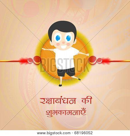 Happy cute little boy holding a big rakhi with wishes on occasion of Happy Raksha Bandhan celebrations.