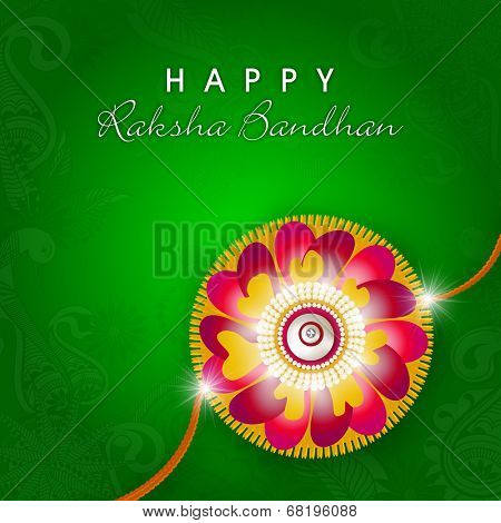 Beautiful floral design decorated rakhi on seamless floral decorated green background for Happy Raksha Bandhan celebrations.