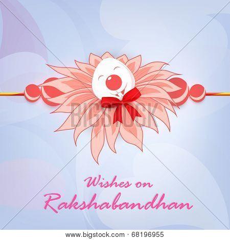 Beautiful pink feather decorated Rakhi on shiny abstract background for Happy Raksha Bandhan celebrations.