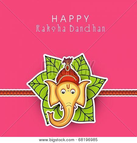 Beautiful rakhi decorated with Hindu mythology Lord Ganesha with mango leaves on pink background for Happy Raksha Bandhan.