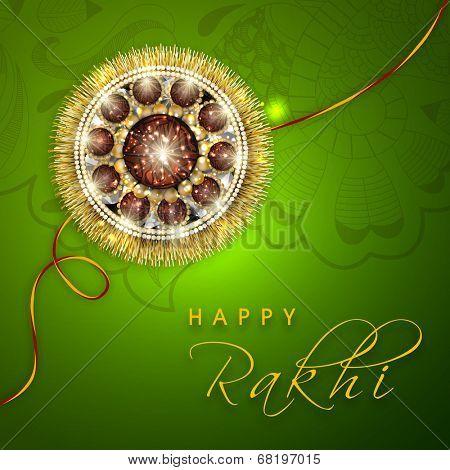 Beautiful rakhi on floral decorated green background for Happy Raksha Bandhan celebrations.